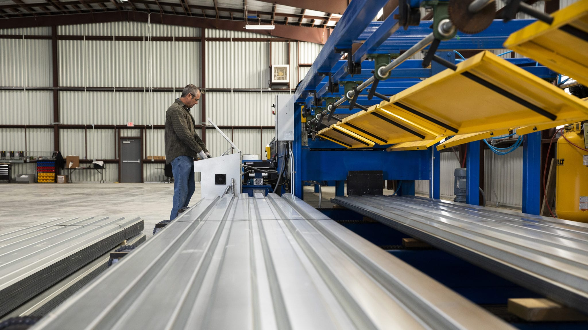 """Our roll forming machine can produce a variety of metal deck, including B-Deck, 1 ½"""" Composite Deck and 1 ½"""" Form Deck."""