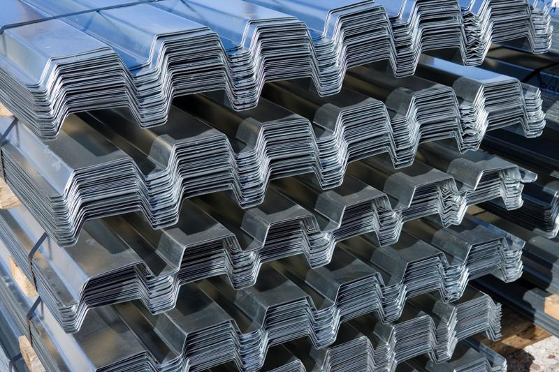 bundles of metal roof deck stacked on top of each other