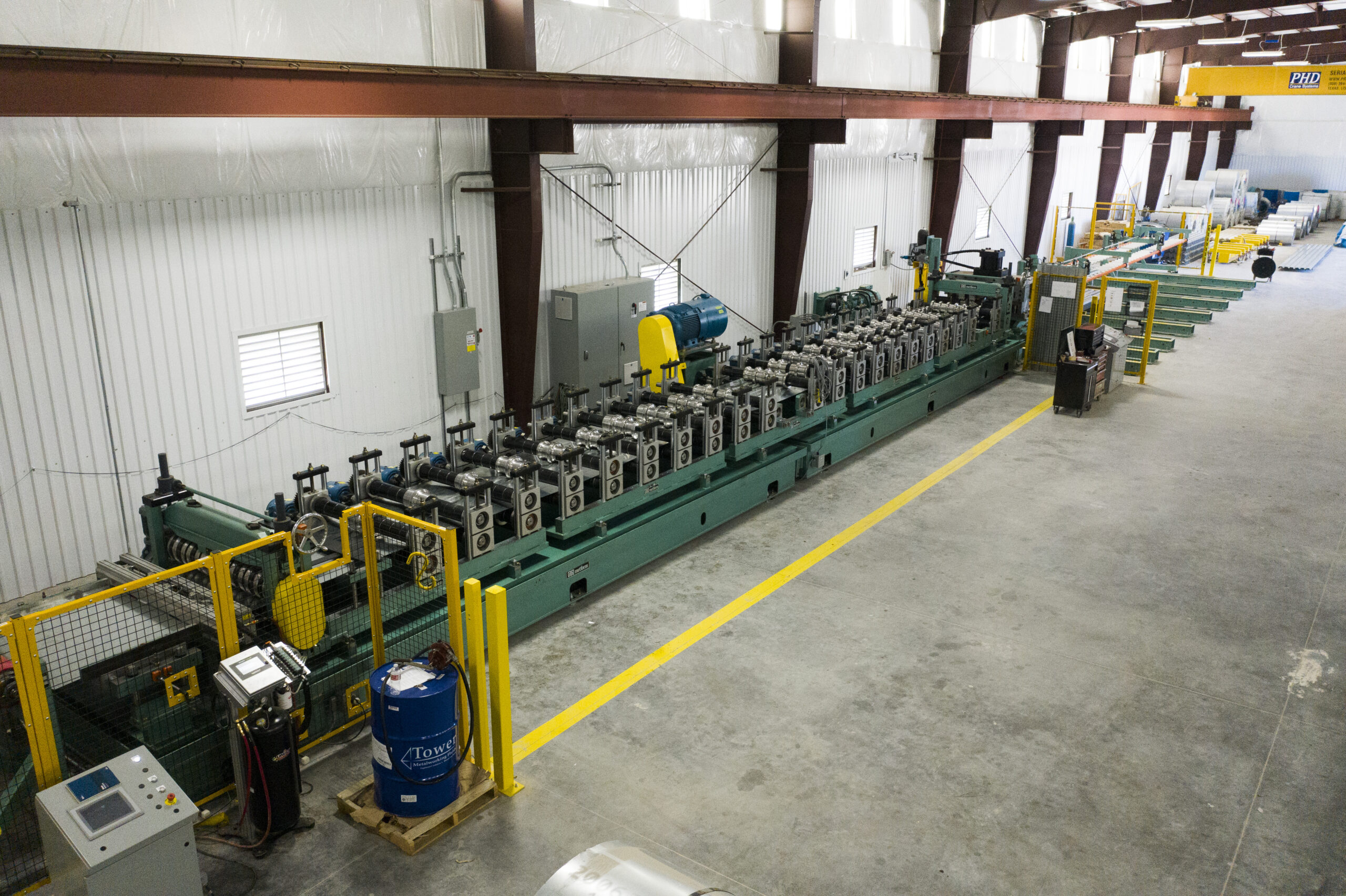csm's metal deck manufacturing equipment in their warehouse facility